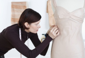 Clothing Designer Pinning a Dress