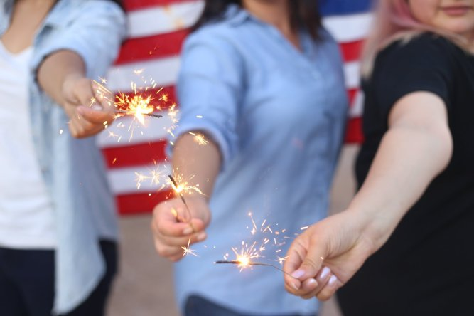 women-with-sparklers